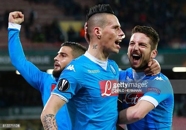 Napoli's Slovak forward Marek Hamsik celebrates with teammates Napoli's Italian forward Lorenzo Insigne and Napoli's Belgian forward Dries Mertens...