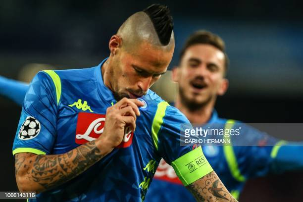 Napoli's Slovak midfielder Marek Hamsik celebrates after opening the scoring during the UEFA Champions League group C football match Napoli vs Red...