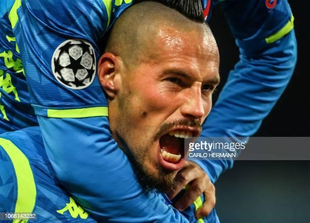 TOPSHOT Napoli's Slovak midfielder Marek Hamsik celebrates after opening the scoring during the UEFA Champions League group C football match Napoli...