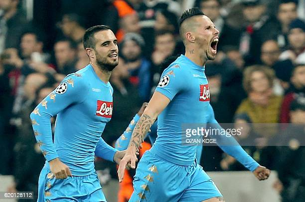 Napoli's Slovak midfielder Marek Hamsik celebrates with teammates after scoring a goal against Besiktas during the UEFA Champions League football...