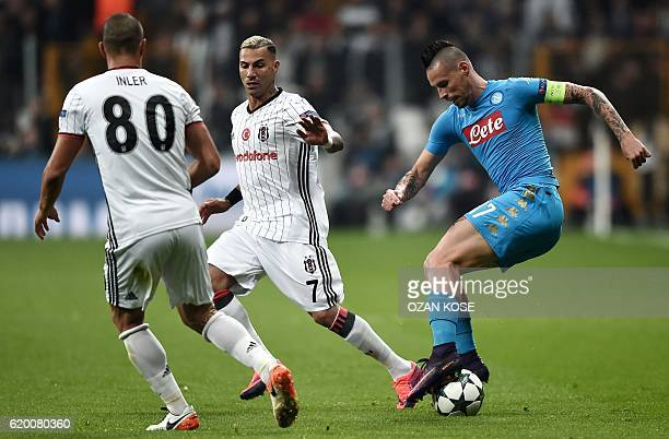 Napoli's Slovak midfielder Marek Hamsik vies for the ball with Besiktas' Portuguese midfielder Ricardo Queresma and Swiss midfielder Gokhan Inler...