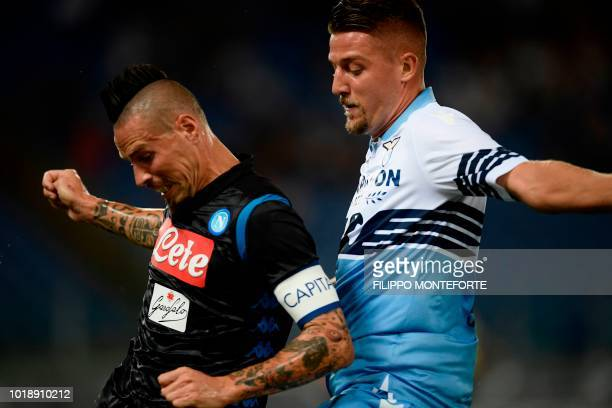 Napoli's Slovakian midfielder Marek Hamsik and Lazio's Serbian midfielder Sergej MilinkovicSavic go for the ball during the Italian Serie A football...