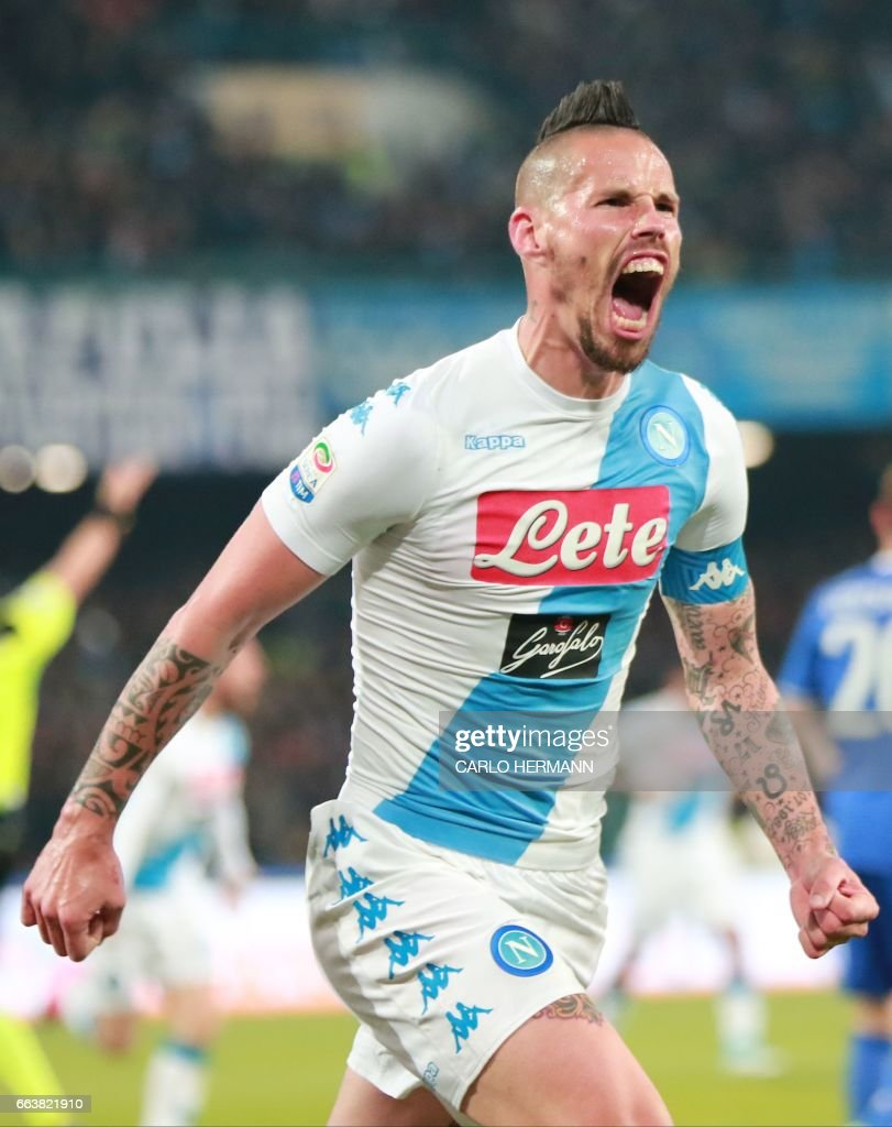 Napoli's Slovakian midfielder Marek Hamsik celebrates after scoring during the Italian Serie A football match SSC Napoli vs Juventus FC on April 2, 2017 at the San Paolo Stadium. /
