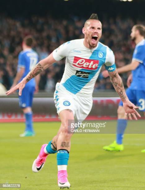 Napoli's Slovakian midfielder Marek Hamsik celebrates after scoring during the Italian Serie A football match SSC Napoli vs Juventus FC on April 2...
