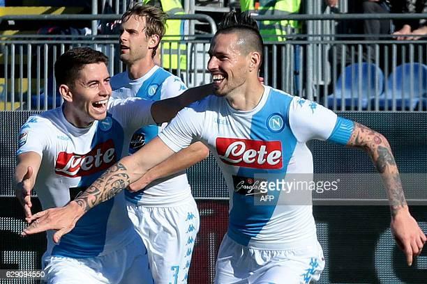 Napoli's Slovakian midfielder Marek Hamsik celebrates with Napoli's Italian-Brazilian midfielder Jorginho and Napoli's Croatian defender Ivan Strinic...
