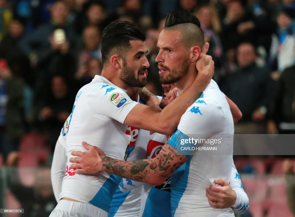 Napoli's Slovakian midfielder Marek Hamsik (R) celebrates with teammate Napoli's defender from Albania Elseid Hysaj after scoring during the Italian Serie A football match SSC Napoli vs Juventus FC on April 2, 2017 at the San Paolo Stadium. /