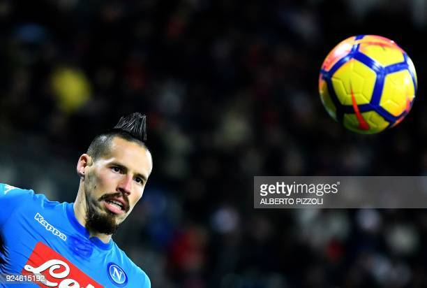 Napoli's Slovakian midfielder Marek Hamsik eyes the ball during the Italian Serie A football match between Cagliari and Napoli at Sardinia stadium in...