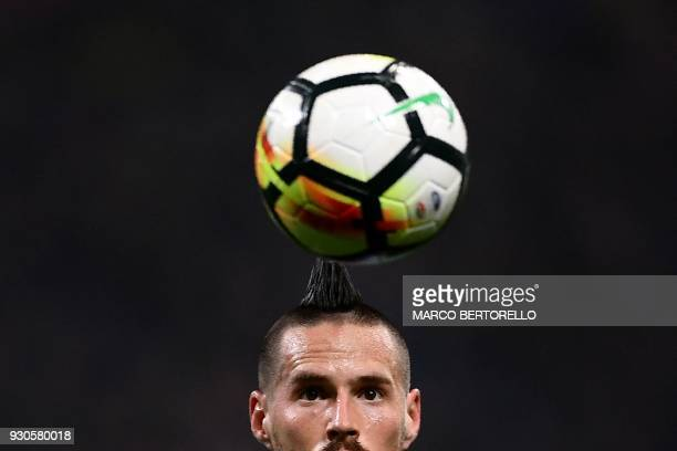 TOPSHOT Napoli's Slovakian midfielder Marek Hamsik eyes the ball during the Italian Serie A football match Inter Milan vs Napoli on March 11 2018 at...