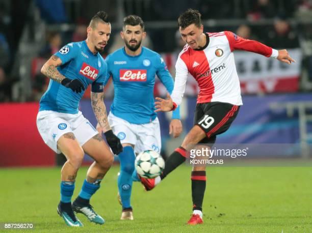 STADIUM ROTTERDAM NETHERLANDS Napoli's Slovakian midfielder Marek Hamsik fights for the ball with Feyenoord's Dutch midfielder Steven Berghuis during...