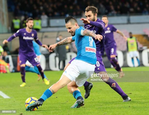 STADIUM NAPLES CAMPANIA ITALY Napoli's Slovakian midfielder Marek Hamsik fights for the ball with Fiorentina's Argentinian defender German Pezzella...