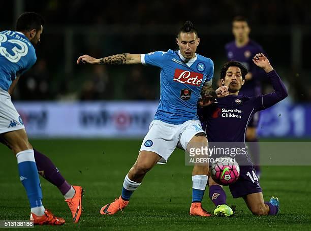 Napoli's Slovakian midfielder Marek Hamsik vies for the ball with Fiorentina's Chilian midfielder Matias Ariel Fernandez during the Italian Serie A...