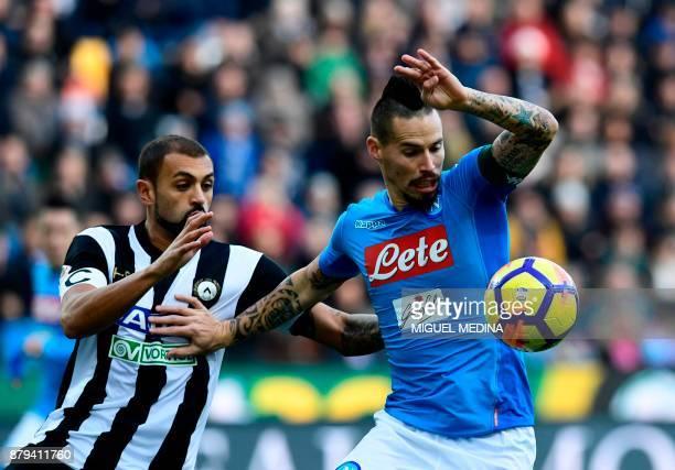 Napoli's Slovakian midfielder Marek Hamsik vies with Udinese's Brazilian defender Danilo Larangeira the Italian Serie A football match Udinese vs...