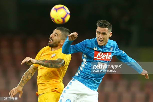 Napoli's Spain striker Jose Maria Callejon fights for the ball with AS Roma Swedish goalkeeper Robin Olsen during the Italian Serie A football match...
