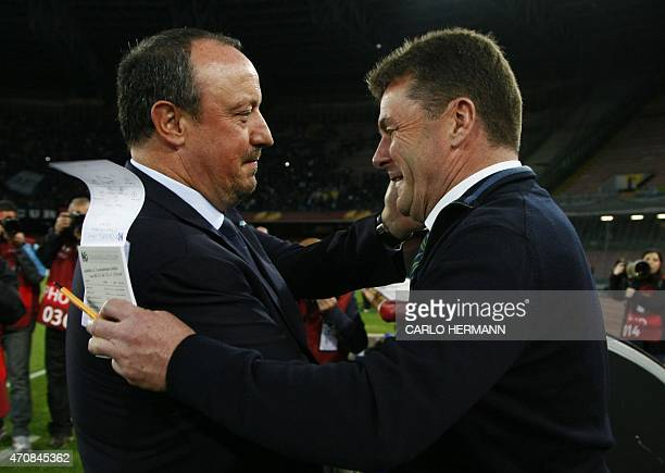 Napoli's Spanish coach Rafael Benitez greets Wolfsburg's German coach from Dieter Hecking before the UEFA Europa League quarter final second leg...