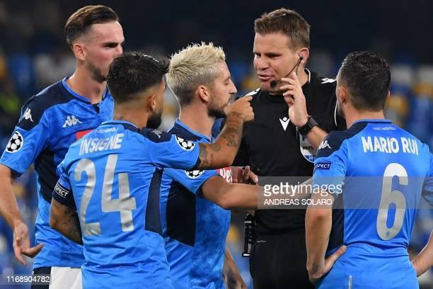 Napoli's Spanish defender Fabian Ruiz Napoli's Italian forward Lorenzo Insigne Napoli's Belgian forward Dries Mertens and Napoli's Portuguese...
