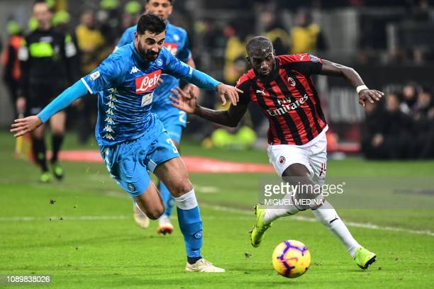 Napoli's Spanish defender Raul Albiol and AC Milan's French midfielder Tiemoue Bakayoko go for the ball during the Italian Serie A football match AC...