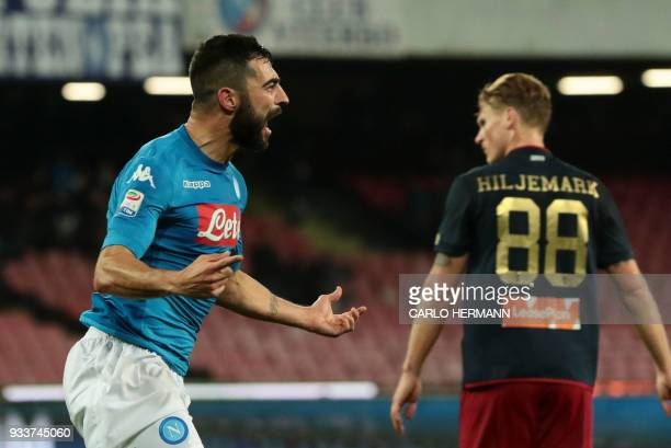 Napoli's Spanish defender Raul Albiol celebrates after scoring during the Italian Serie A football match SSC Napoli vs Genoa CFC on March 18, 2018 at...