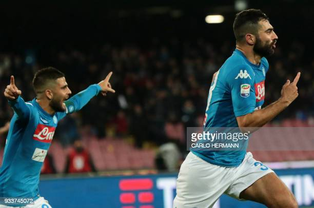 Napoli's Spanish defender Raul Albiol celebrates after scoring next to teammate Napoli's Italian striker Lorenzo Insigne during the Italian Serie A...