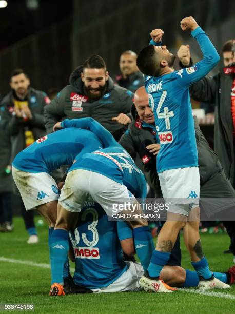 Napoli's Spanish defender Raul Albiol celebrates with teammates after scoring during the Italian Serie A football match SSC Napoli vs Genoa CFC on...