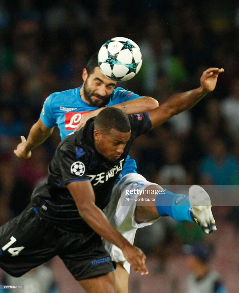 Napoli's Spanish defender Raul Albiol (top) fights for the ball with Nice's French forward Alassane Plea during the UEFA Champions League Play Off first leg football match SSC Napoli vs OCG Nice, on August 16 2017 at the San Paolo Stadium. /