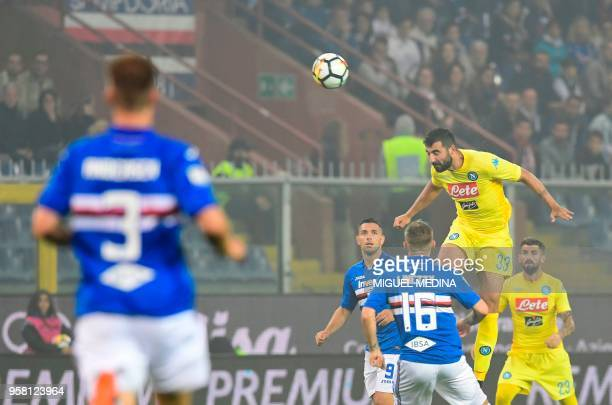 Napoli's Spanish defender Raul Albiol heads the ball during the Italian Serie A football match Sampdoria vs Napoli on May 13 2018 at the Luigi...