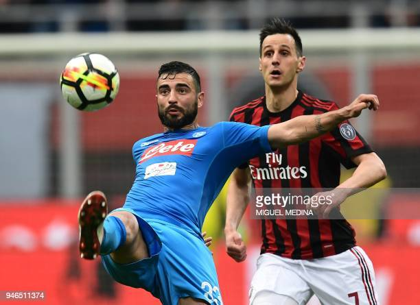 Napoli's Spanish defender Raul Albiol vies with AC Milan's Craotian forward Nikola Kalinic during the Italian Serie A football match between AC Milan...