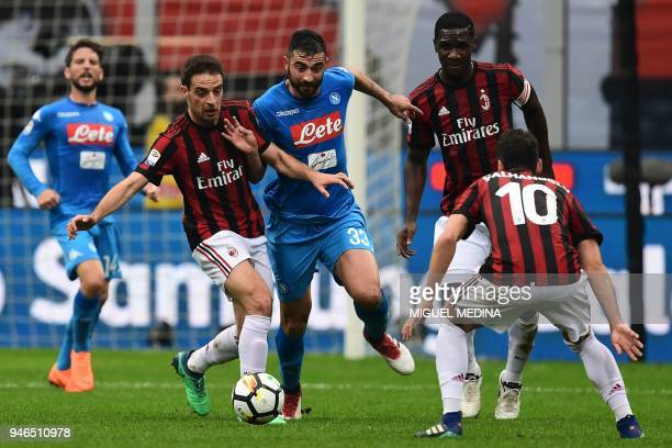 Napoli's Spanish defender Raul Albiol vies with AC Milan's Italian midfielder Giacomo Bonaventura and AC Milan's Colombian defender Cristian Zapata...