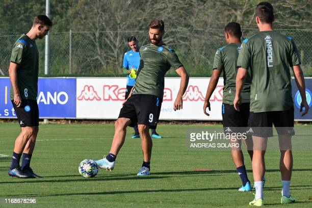 Napoli's Spanish forward Fernando Llorente passes the ball to a teammate during a training session at SSC Napoli training Center in Castel Volturno,...