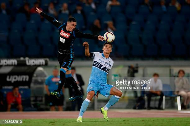 Napoli's Spanish forward Jose Callejon and Lazio's Argentinian midfielder Joaquin Correa go for the ball during the Italian Serie A football match...