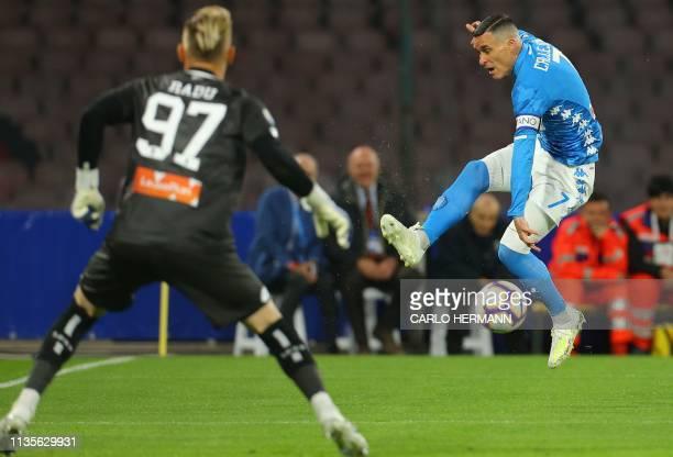 Napoli's Spanish forward Jose Callejon challenges Genoa's Romanian goalkeeper Ionut Andrei Radu during the Italian Serie A football match Napoli vs...