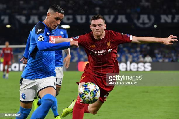 Napoli's Spanish forward Jose Callejon challenges Liverpool's Scottish defender Andrew Robertson during the UEFA Champions League Group E football...
