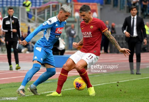 Napoli's Spanish forward Jose Callejon fights for the ball with AS Roma's Serbian defender Aleksandar Kolarov during the Italian Serie A football...