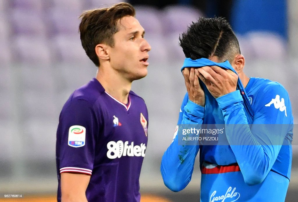 Napoli's Spanish forward Jose Callejon (R) reacts as he leaves the field past Fiorentina's forward Federico Chiesa following the Italian Serie A football match Fiorentina vs Napoli on April 29, 2018 at Artemio-Franchi stadium in Florence.