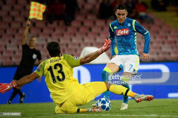 Napoli's Spanish forward Jose Callejon shoots against Liverpool's Brazilian goalkeeper Alisson during the UEFA Champions League group C football...