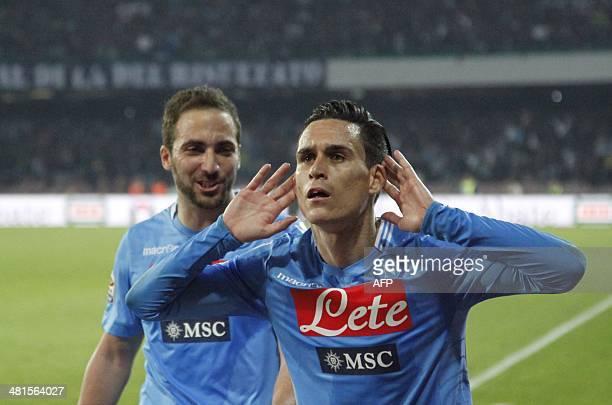 Napoli's Spanish forward Jose Maria Callejon celebrates with teammate Napoli's Argentinian forward Gonzalo Higuain after scoring during the Italian...