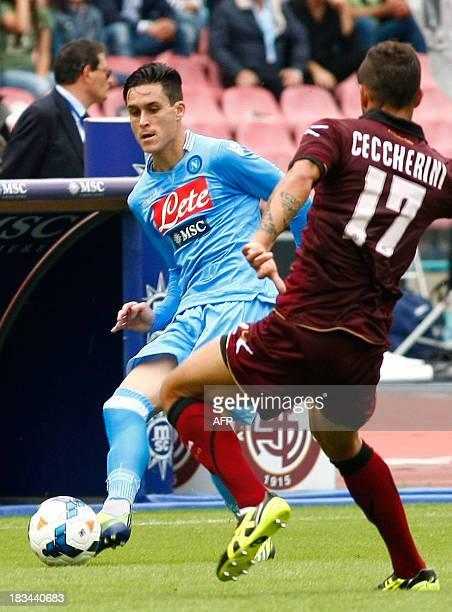 Napoli's Spanish forward Jose Maria Callejon fights for the ball with Livorno's Gahanian midfielder Federico Ceccherini during the Italian Serie A...