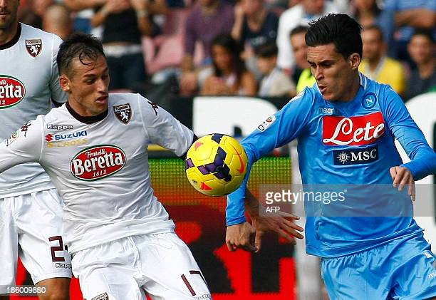 Napoli's Spanish forward Jose Maria Callejon fights for the ball with Torino's defender Salvatore Masiello during the Italian Serie A football match...