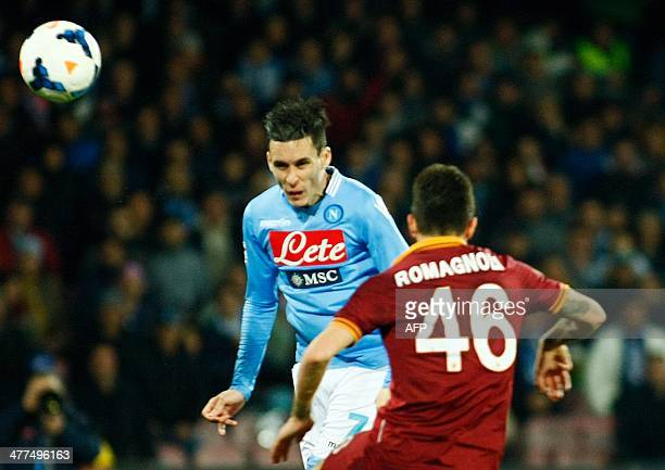 Napoli's Spanish forward Jose Maria Callejon scores a header during the Italian Serie A football match between SSC Napoli and AS Roma in San Paolo...