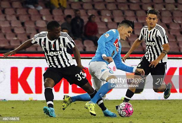 Napoli's Spanish forward Jose Maria Callejon vies with Juventus' French defender Patrice Evra and Juventus' Argentinian forward Paulo Dybala during...