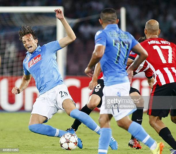 "Napoli's Spanish forward Miguel Perez Cuesta ""Michu"" falls during the first leg of the UEFA Champions League play off football match between SSC..."