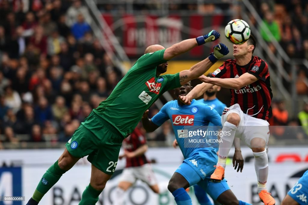 Napoli's Spanish goalkeeper Jose Manuel Reina (L) punches the ball during the Italian Serie A football match AC Milan vs Napoli at the San Siro stadium in Milan on April 15, 2018. stadium in Milan on October 1, 2017. /