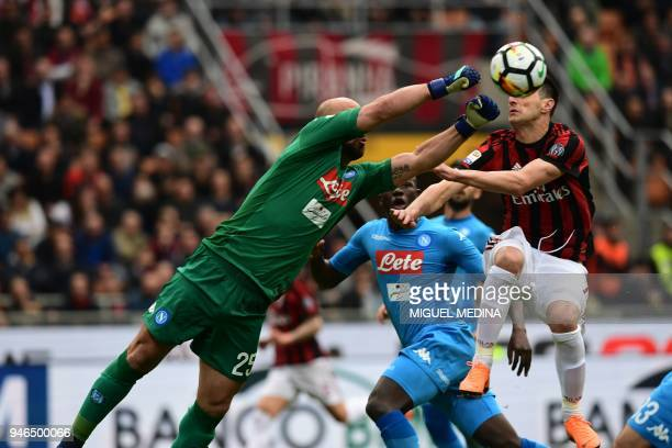 Napoli's Spanish goalkeeper Jose Manuel Reina punches the ball during the Italian Serie A football match AC Milan vs Napoli at the San Siro stadium...