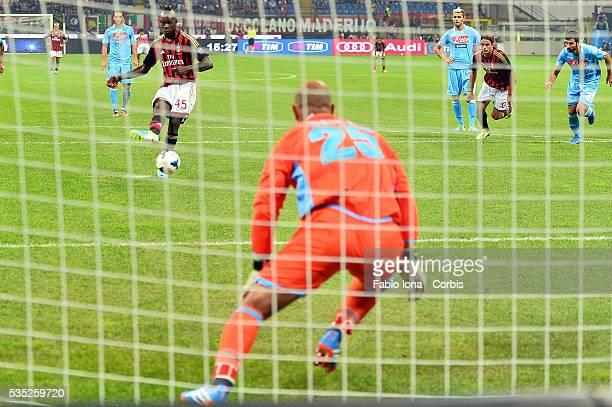 Napoli's Spanish goalkeeper Jose Manuel Reina saves a penalty kick shot by AC Milan's forward Mario Balotelli during the Serie A football match AC...