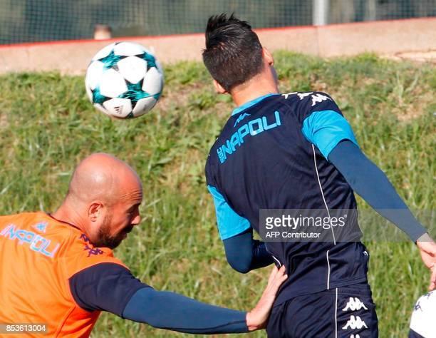 Napoli's Spanish goalkeeper Pepe Reina and teammate Napoli's Spanish forward Jose Maria Callejon attend a training session on the eve of the UEFA...