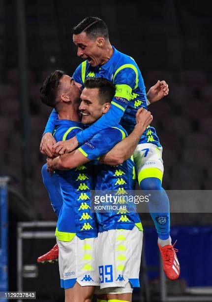 Napoli's Spanish midfielder Fabian Ruiz celebrates with teammates Napoli's Spanish striker Jose Maria Callejon and Napoli's Polish striker Arkadiusz...