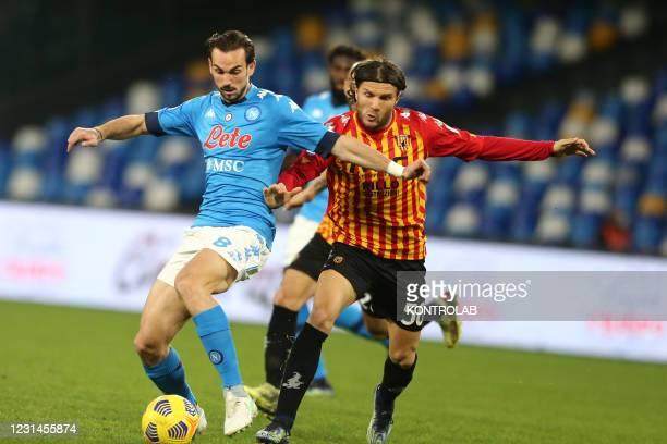 Napoli's Spanish midfielder Fabian Ruiz challenges for the ball with Beneventos Finnish midfielder Perparim Hetemaj during the Serie A football match...