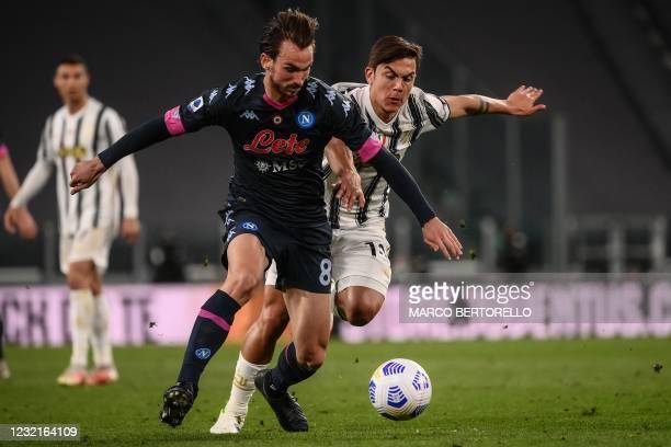 Napoli's Spanish midfielder Fabian Ruiz challenges Juventus' Argentine forward Paulo Dybala during the Italian Serie A football match Juventus vs...