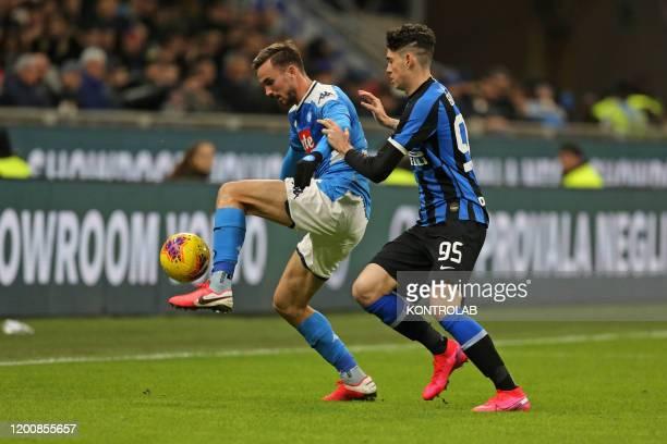 Napoli's Spanish midfielder Fabian Ruiz fights for the ball with Inter Milan's Italian defender Alessandro Bastoni during the Italian Tim Italy Cup...