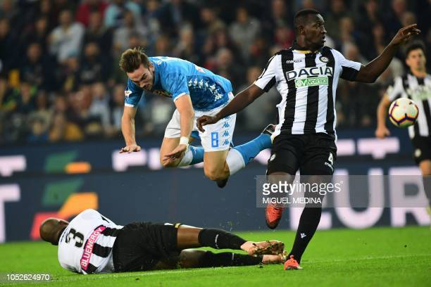 Napoli's Spanish midfielder Fabian Ruiz jumps over Udinese's Brazilian defender Samir as Udinese's Ghanaian defender Nicholas Opoku looks on during...