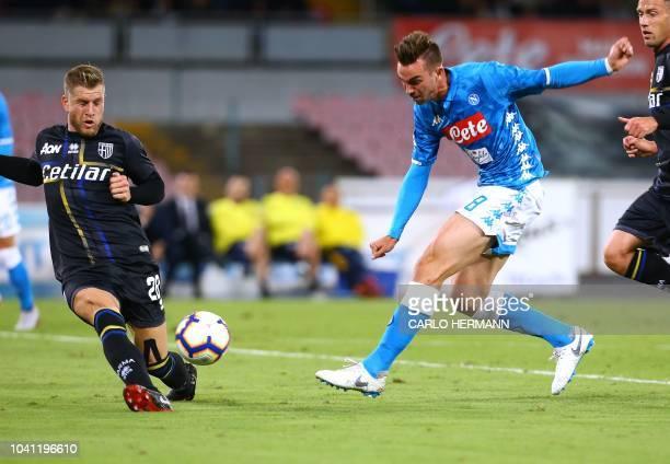 Napoli's Spanish midfielder Fabian Ruiz kicks the ball as Parma's Italian defender Riccardo Gagliolo stops it during the Italian Serie A football...